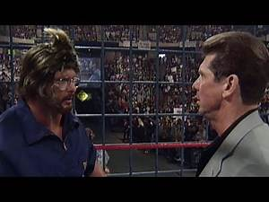 """""""Stone Cold"""" Steve Austin disguises himself as a cameraman to launch a sneak attack on Mr. McMahon"""