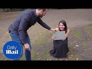 Hypnotist tricks people in being completely naked in a public park
