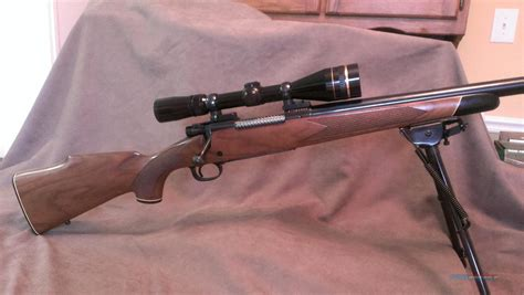243 Rifle With Heavy Barrel And A Woman Fires A Rifle With Barrel Length Of