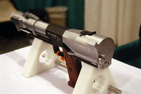 50 Bmg Handgun And Hello Kitty Handgun