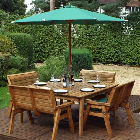8 seater garden table with bench seats Image