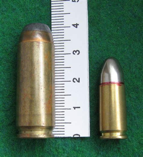 Desert-Eagle 9mm Pistol Bullet Next To Desert Eagle 50 Cal Bullet.