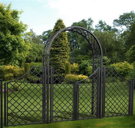 Arched garden gate with frame Image