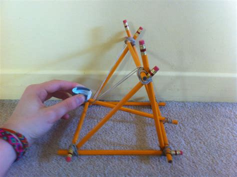 Build a catapult with pencils Image