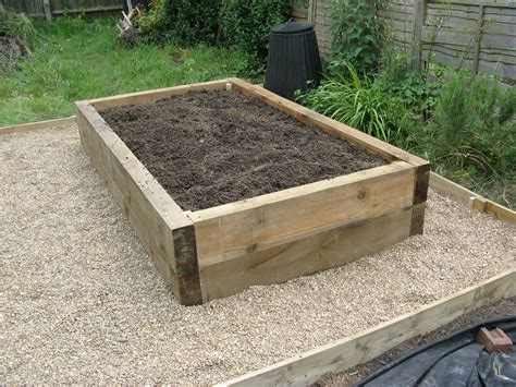 Build raised garden beds with sleepers Image