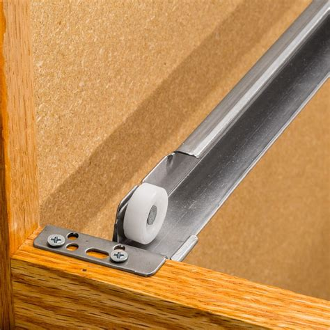 Cabinet Drawer Construction With Roller Slides For Drawers