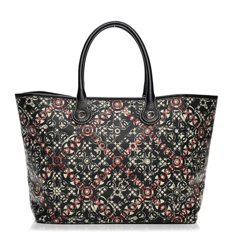 c4ac815326bca9 Chanel Black Coated Canvas & Leather Quilted Rue Cambon Tote.