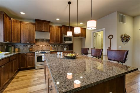 Chestnut Cabinets With Light Granite
