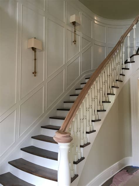 Curved Staircases With Millwork On The Walls