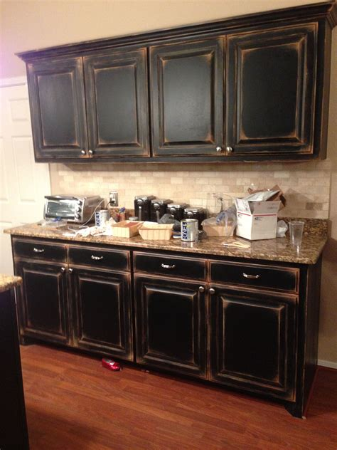DIY Distressed Black Cabinets
