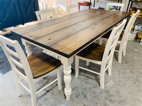 Dark Farm Table With White Chairs