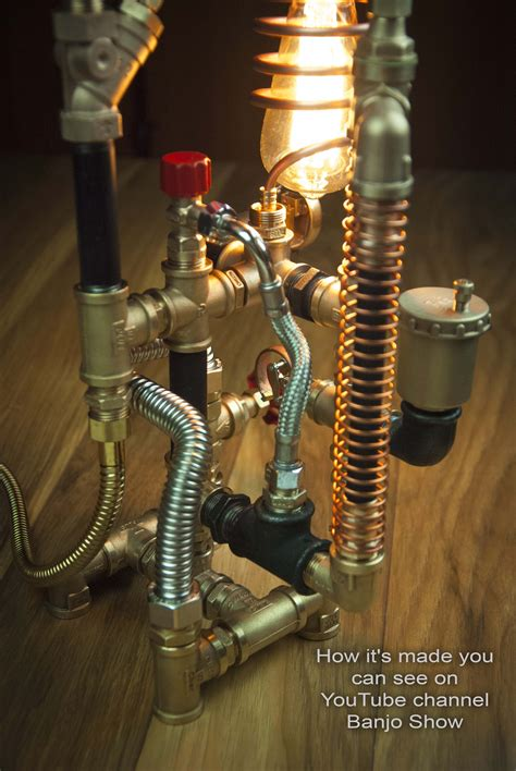 Diy Industrial Pipe Lighting On Beam