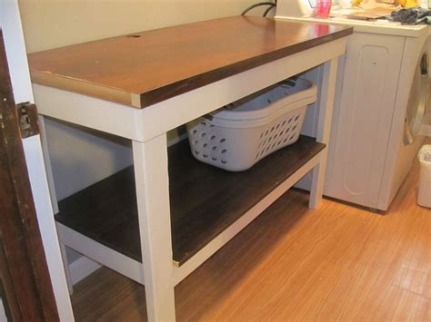 Diy Laundry Room Folding Table And Cabinets