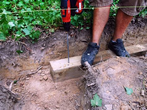 Diy Wood Retaining Wall Rebar Spikes On The Roadway