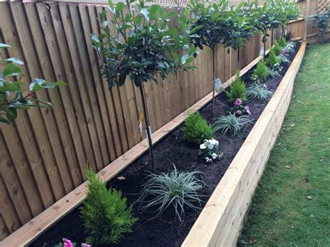 Diy Wooden Raised Garden Bed Along Back Fence