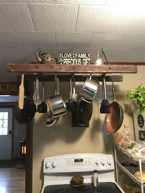 Diy-Pots-And-Pans-Ladder-Rack-With-Chandelier