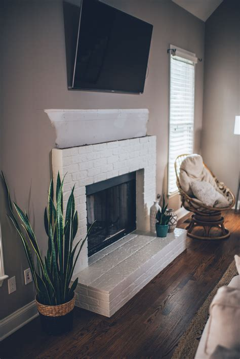 Diy-Wood-Mantel-On-Brick-Fireplace