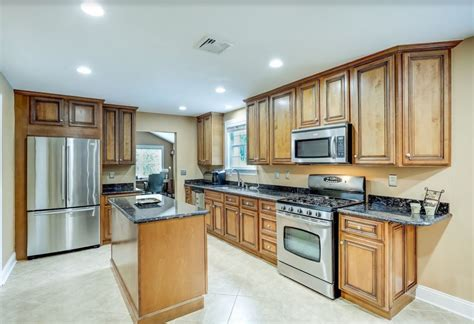 English Oak Cabinets With Stainless Appliances