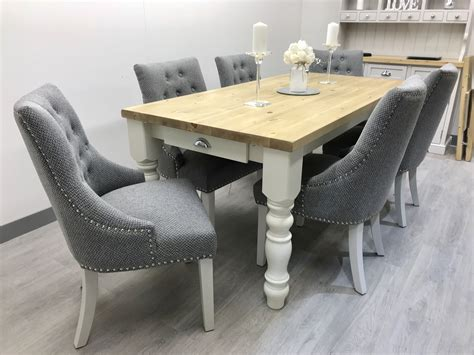 Gray-Fabric-Chairs-With-Farmhouse-Table