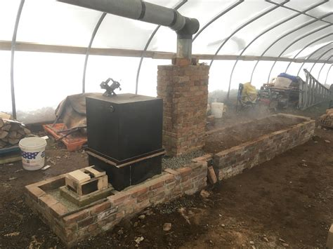 Greenhouse-Rocket-Mass-Heater-Plans