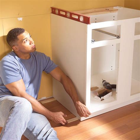How To Attach Cabinets To Wall