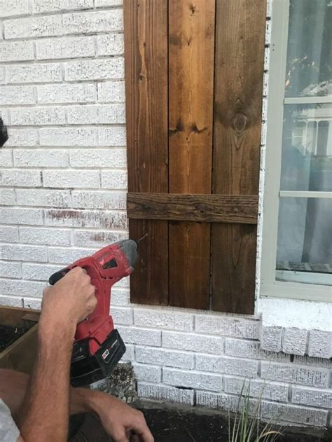 How To Hang Wood Shutters On Brick