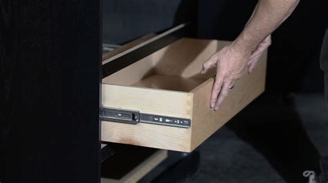 How To Put Cabinet Drawers Back In