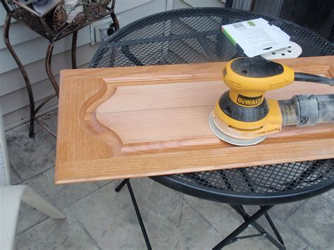 How To Use Sandpaper To Distress Cabinets