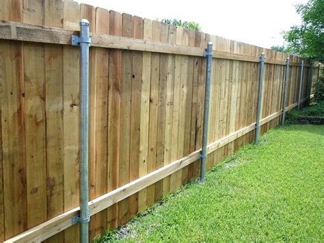 Installing Wood Fence Panels With Metal Posts