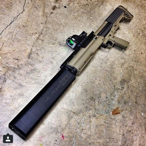 Kel-Tec Ksg With A Silencerco Salvo 12 Suppressor .