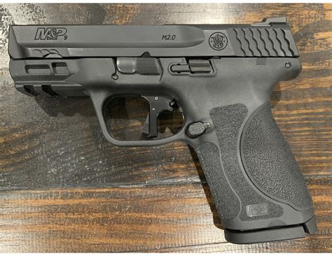 M P Compact 3 6 And Spyderco Nilakka G 10 Plain Edge Knife Brown