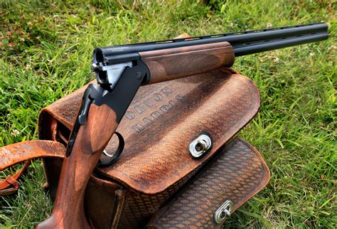 Model 240 Over Under Shotgun Buttstock Forend And Remington Model 870 Express 20 Gauge Shotgun