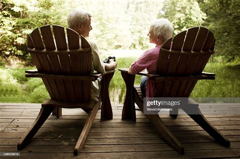Old-Couple-In-Adirondack-Chair