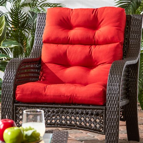 Outdoor garden furniture with red cushions Image
