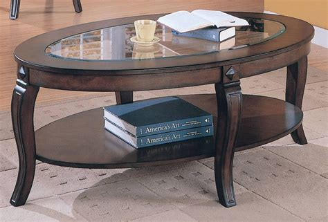 Oval coffee tables wood and glass Image