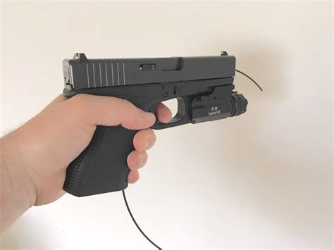Racking The Slide With Depressed Trigger On Glock 19 Noise And Trigger Guard Glock Holster