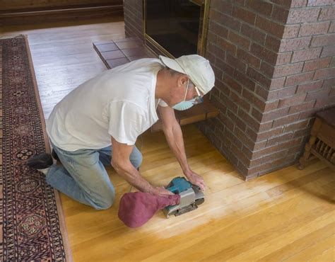 Refinishing A Wood Floor With A Palm Sander