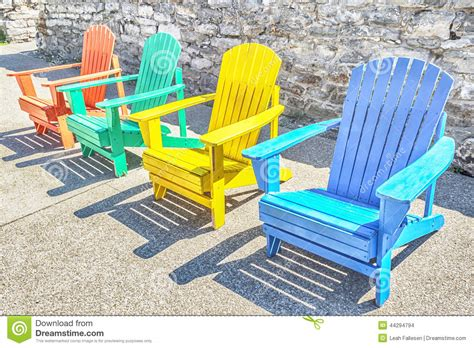 Row-Of-Adirondack-Chairs-Colorful