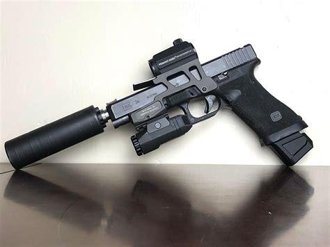 Suppressed Glock 34 And Glock 43 Trijicon