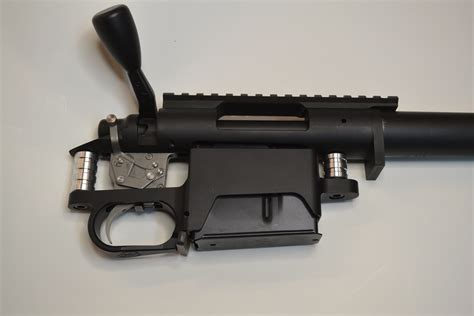 Surgeon Rifles Long Action Bottom Metal Surgeon Rifles And Power Custom Sks Extended Magazine Release The Jewelry King