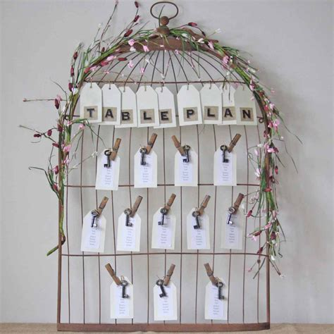 White Birdcage Wedding Table Plan
