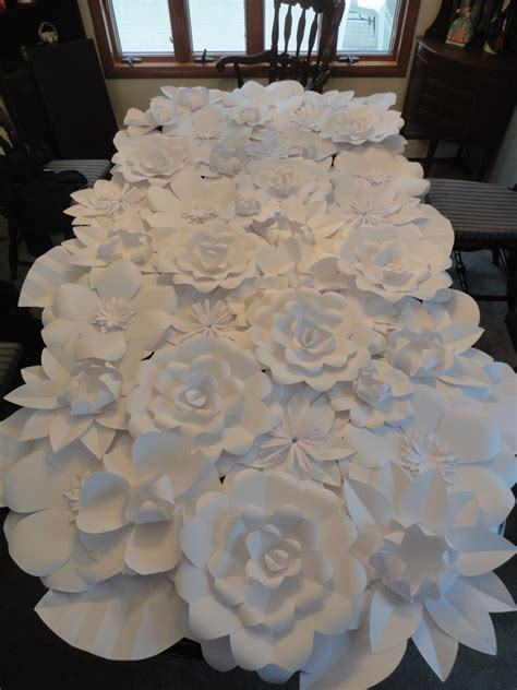 White Brick Wall Decorated With Paper Flowers