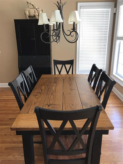 White-Farmhouse-Table-And-Black-Chairs