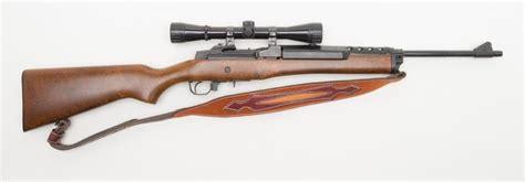 Wood Stocked Semi Auto 223 Rifle And 25 Caliber Rifle Bullets