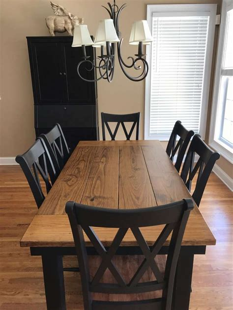 Wood-Farmhouse-Table-With-Black-Chairs