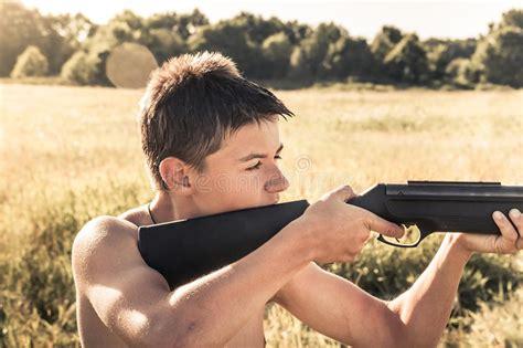 Aiming Handgun At Man Face