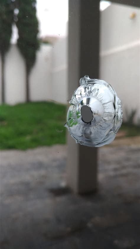 Air Rifle Hole In Glass