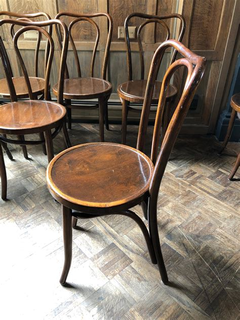 Antique wooden dining chairs Image