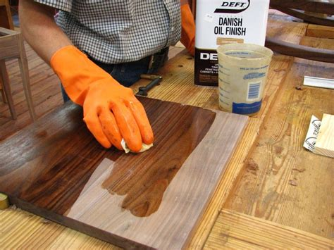 Applying tung oil finish Image