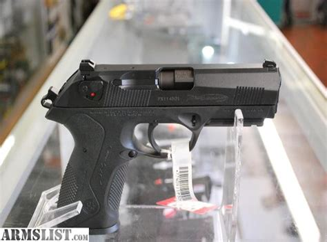 Beretta Handgun With Rotating Barrel